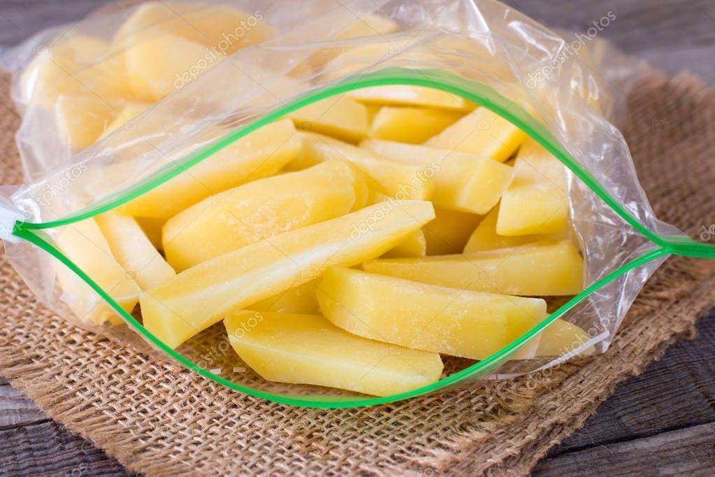 depositphotos 188489064 stock photo frozen potatoes in a bag